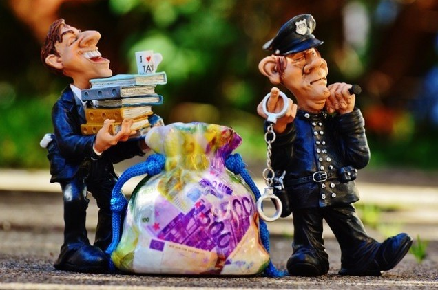 taxes-tax-evasion-police-handcuffs (1)